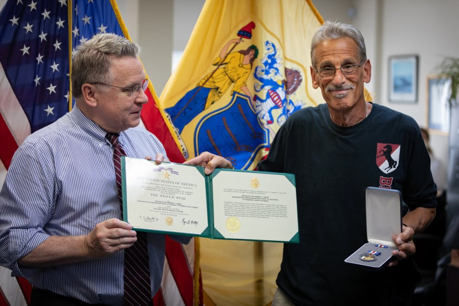 "Rep. Chris Smith, left, presents Vietnam War veteran Bart ""Doc"" Fabian with his second Silver Star"